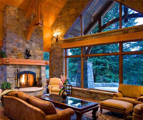 living room of a custom built acreage with rock fireplace